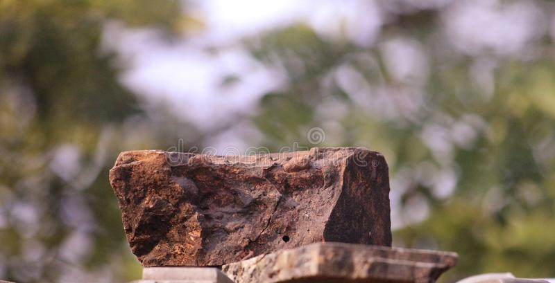 A piece of reddish rock stone stock photo
