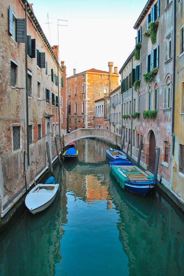 Venetian canal street and a bridge stock photos