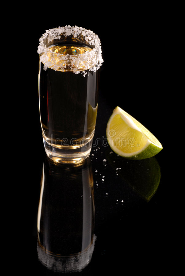 Shot of tequila on black stock photo