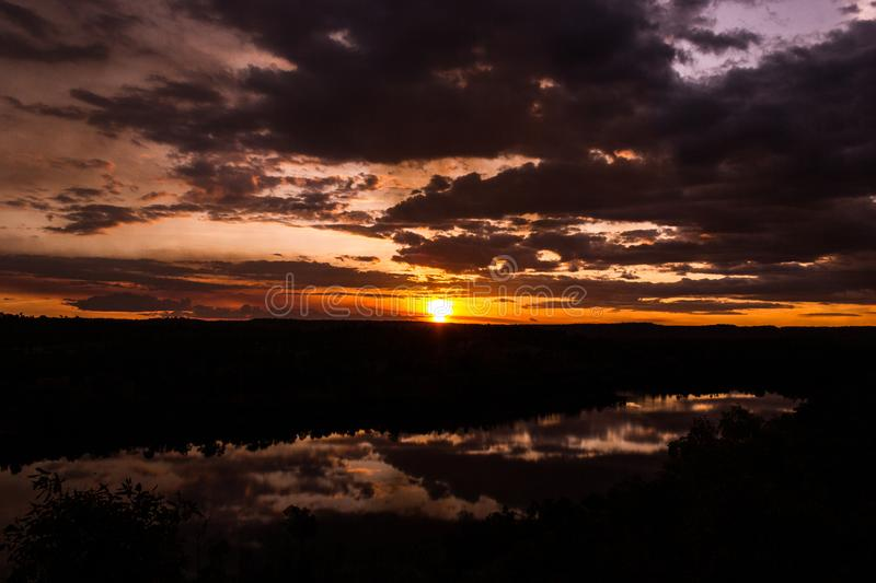Shot through tress of a beautiful sunset in the australian outback with 1 lakes, Nitmiluk National Park, Australia. Shot through tress of a beautiful sunset in stock images
