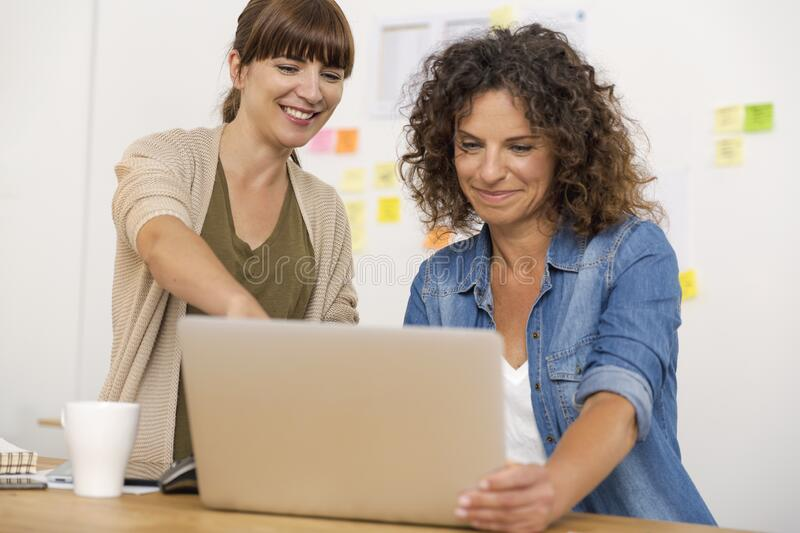 Two businesswoman working together royalty free stock image