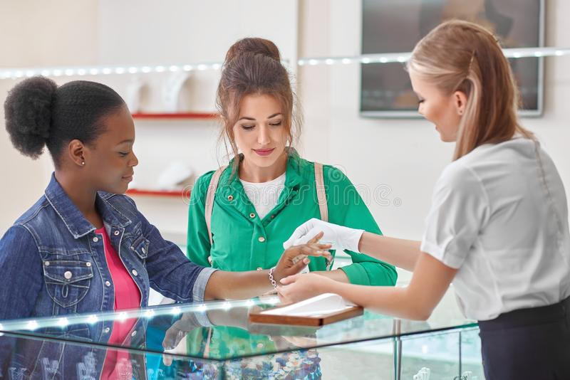 Female friends at the jewelry store stock photography
