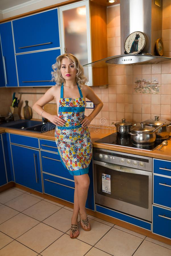 Attractive Naked Blond Housewife In An Apron Alone In A