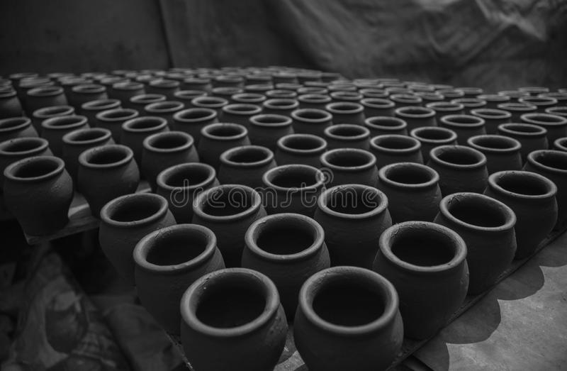Pots orderly arranged royalty free stock images