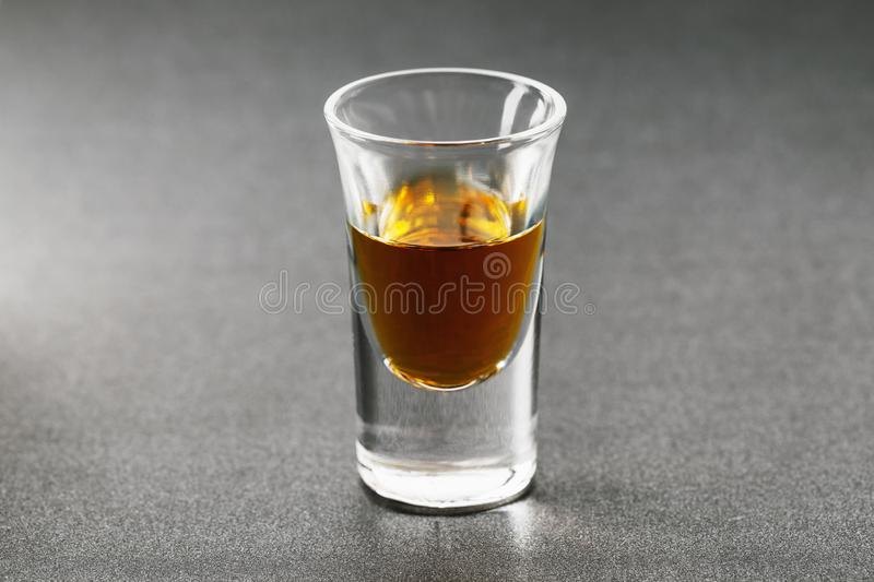 Shot with whiskey on a dark background stock image