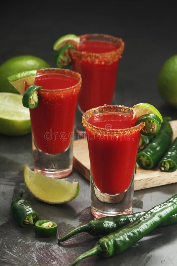 Shots with sangrita - traditional Mexican cocktail stock photography