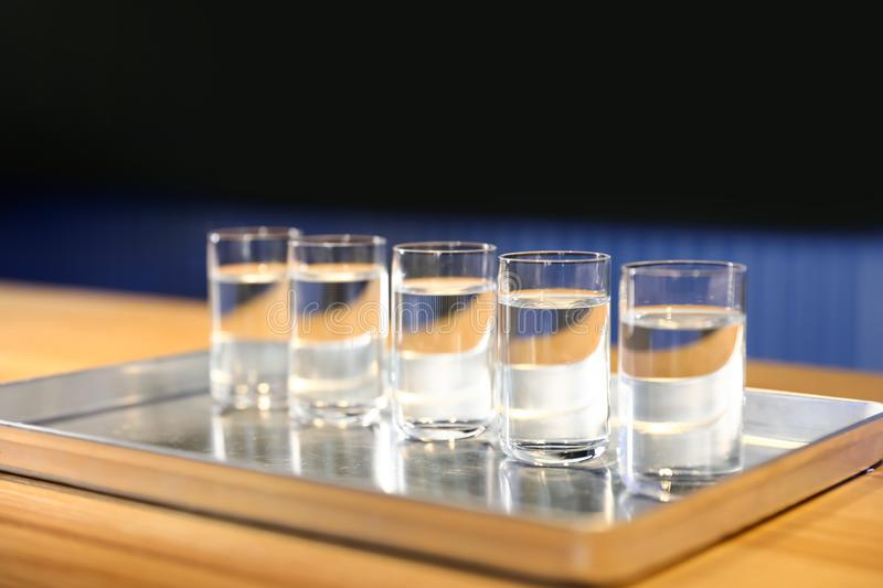 Shots of vodka on bar counter stock images