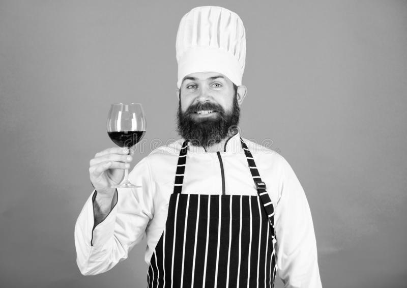 This should be fine. Alcoholic drink. Red wine in glass. This wine is just perfect. Confident male sommelier examining royalty free stock photo