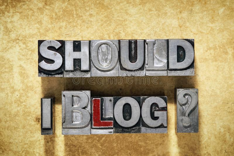 Should I blog. Question made from metallic letterpress type on grunge cardboard background royalty free stock image