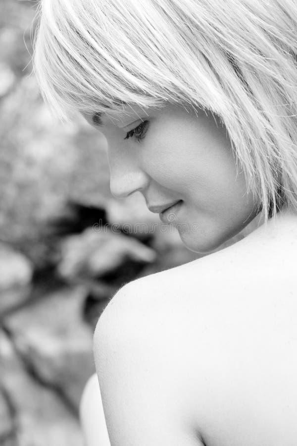 Shoulder Glance. Close up shot of model looking over shoulder royalty free stock photos