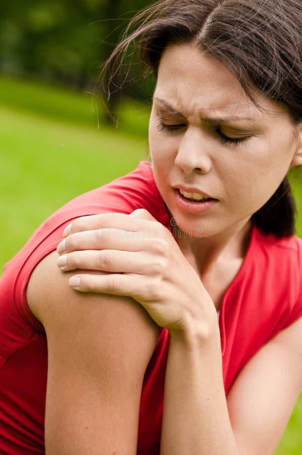 Shoulder injury - sportswoman royalty free stock image