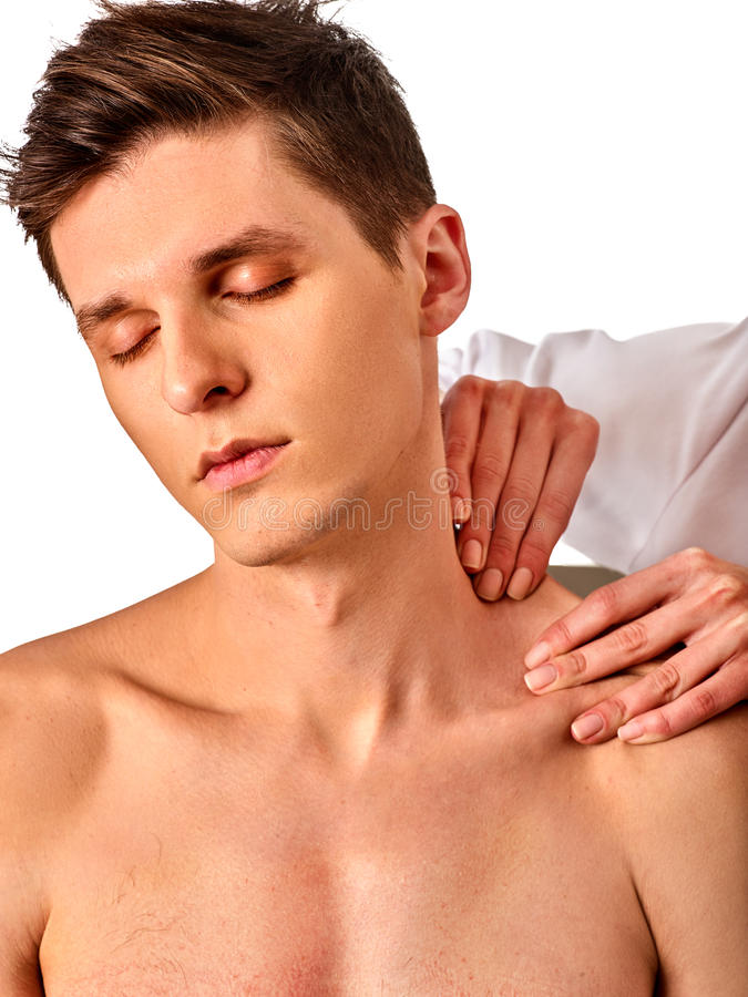 Shoulder and neck massage for man in spa salon. Doctor making therapy in rehabilitation center. Correction of dislocation of neck by experienced specialist stock photo