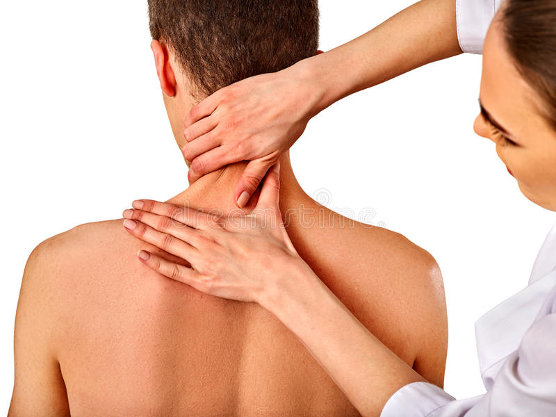 Shoulder and neck massage for man in spa salon. Shoulder and neck massage for men in spa salon. Doctor making neck therapy in rehabilitation center. Folded stock image