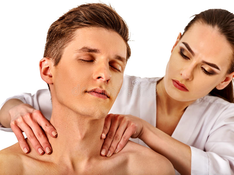 Shoulder and neck massage for man in spa salon. Shoulder and neck massage for men in spa salon. Doctor making neck therapy in rehabilitation center on isolated royalty free stock image