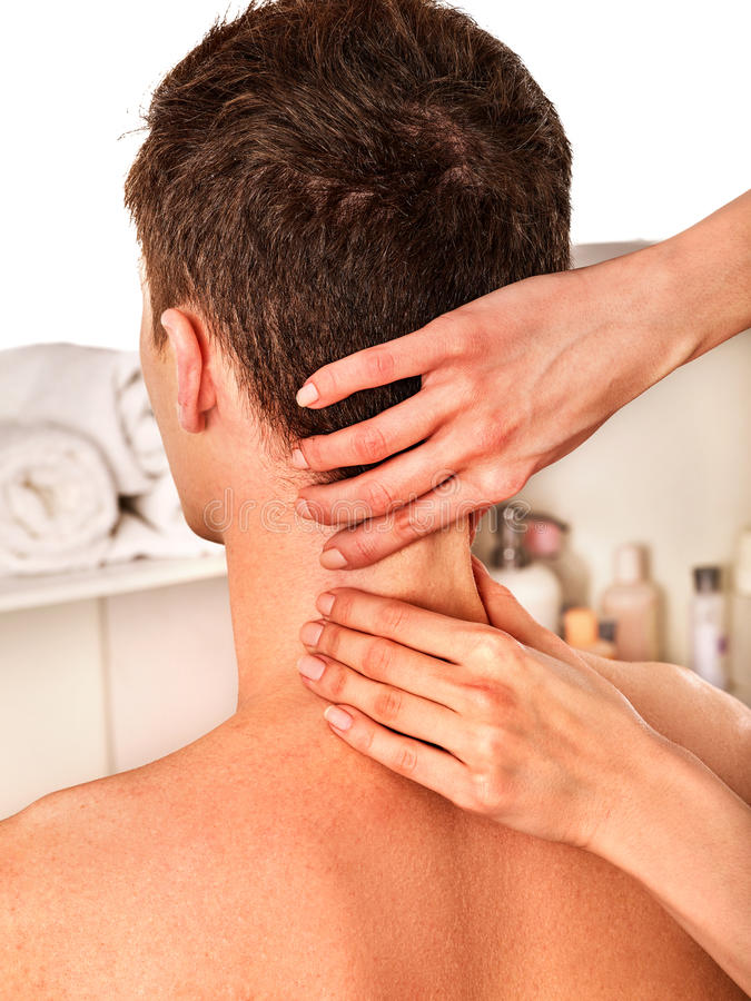Shoulder and neck massage for man in spa salon. Shoulder and neck massage for men in spa salon. Doctor making neck therapy in rehabilitation center royalty free stock photo