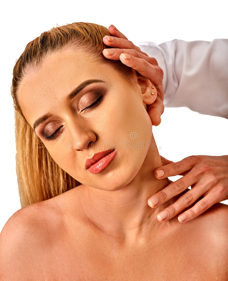 Shoulder and neck massage for woman in spa salon. Doctor making neck therapy in rehabilitation center on isolated. Direction of a dislocation in a specialized royalty free stock image