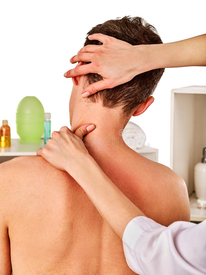 Shoulder and neck massage for woman in spa salon. Doctor making therapy in rehabilitation center . Reinforcement of joint in good clinic. Back view royalty free stock images