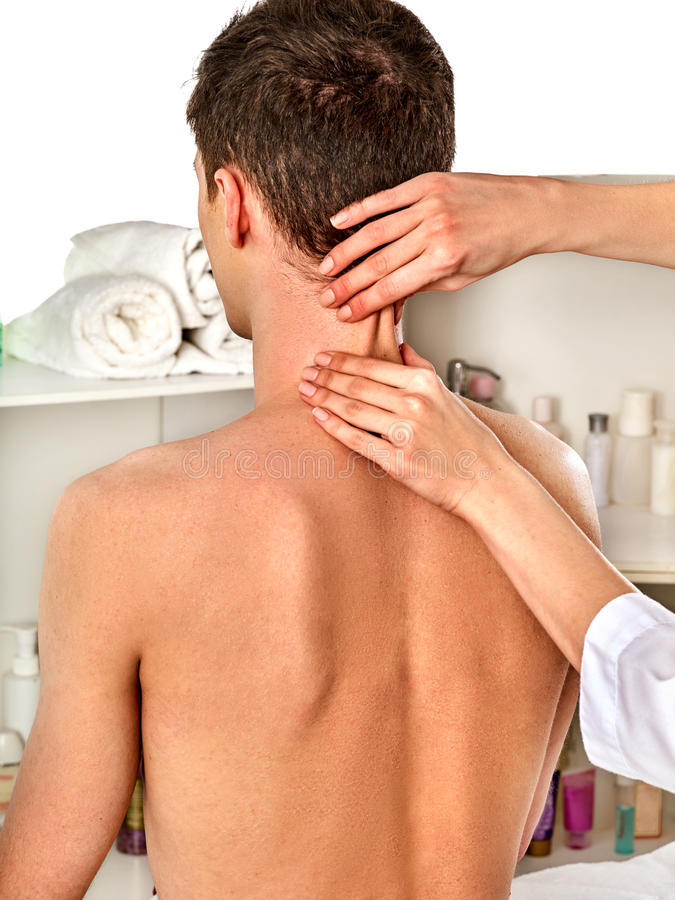 Shoulder and neck massage for woman in spa salon. Doctor making therapy in rehabilitation center . Reinforcement of joint in good clinic. Nude back view stock image