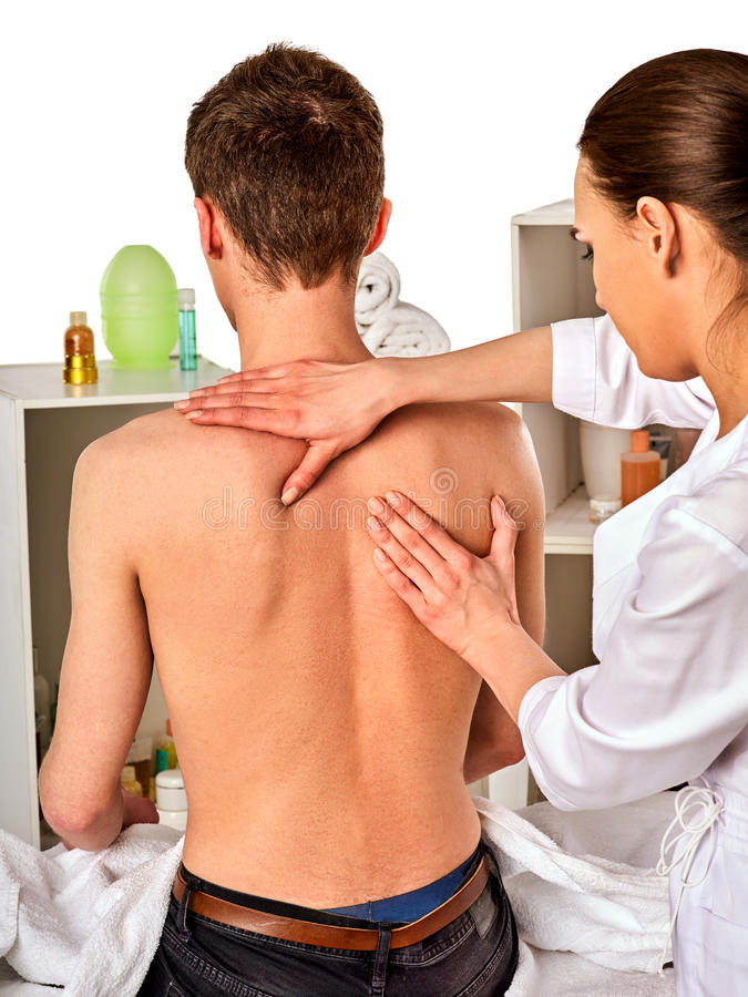 Shoulder and neck massage for woman in spa salon. Shoulder and neck massage for women in spa salon. Doctor making neck therapy in rehabilitation center stock photos
