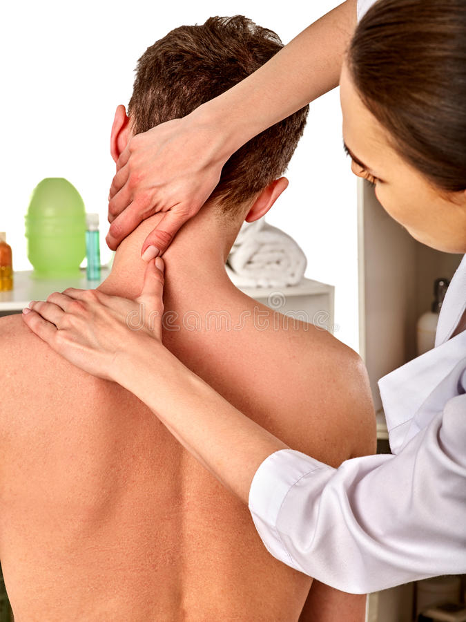 Shoulder and neck massage for woman in spa salon. Shoulder and neck massage for women in spa salon. Doctor making neck therapy in rehabilitation center stock images