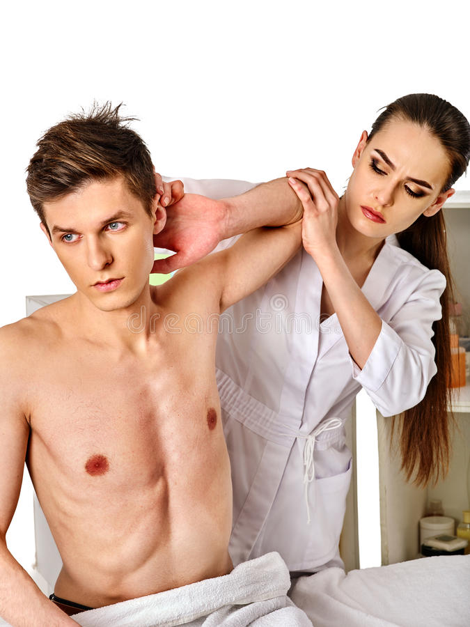Shoulder and neck massage for woman in spa salon. Shoulder and neck massage for women in spa salon. Doctor making neck therapy in rehabilitation center royalty free stock photography