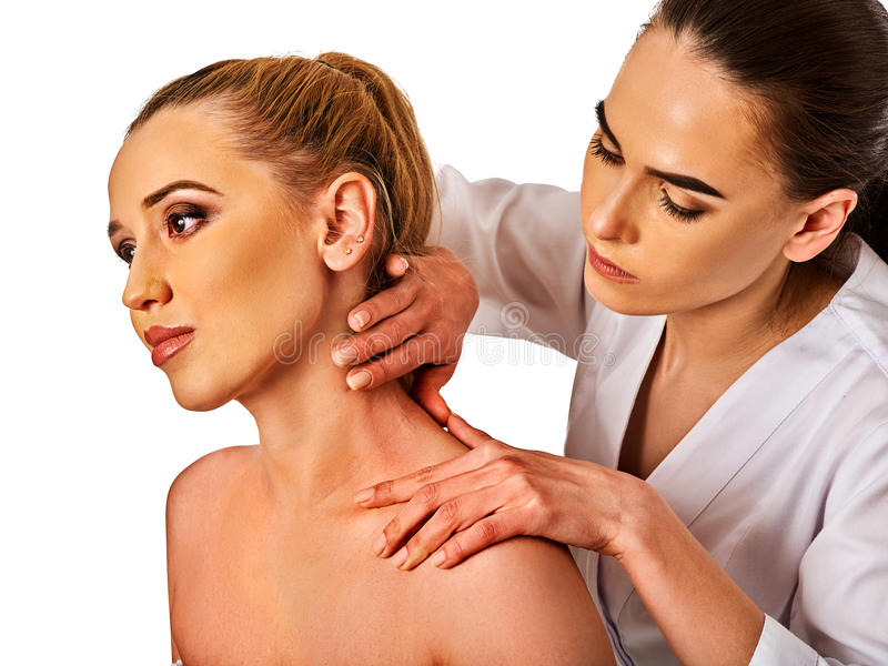 Shoulder and neck massage for woman in spa salon. Shoulder and neck massage for women in spa salon. Doctor making neck therapy in rehabilitation center on stock image