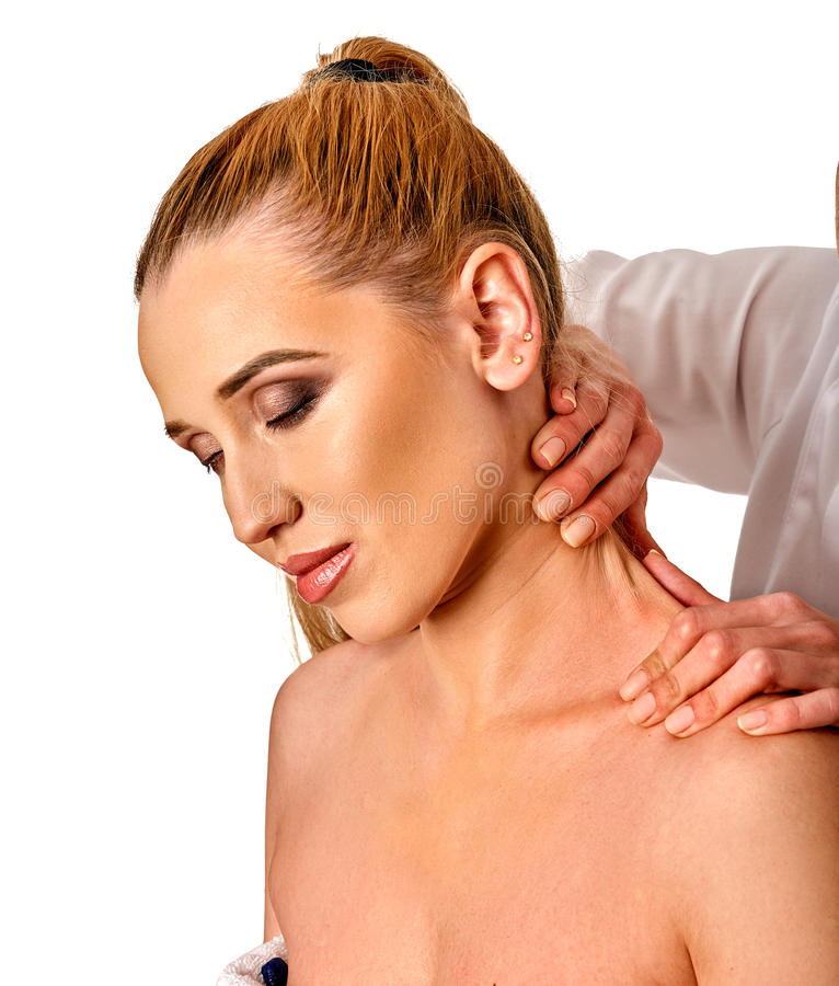 Shoulder and neck massage for woman in spa salon. Shoulder and neck massage for women in spa salon. Doctor making neck therapy in rehabilitation center on stock photography
