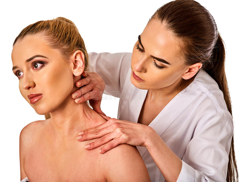 Shoulder and neck massage for woman in spa salon. Shoulder and neck massage for women in spa salon. Doctor making neck therapy in rehabilitation center on royalty free stock photo