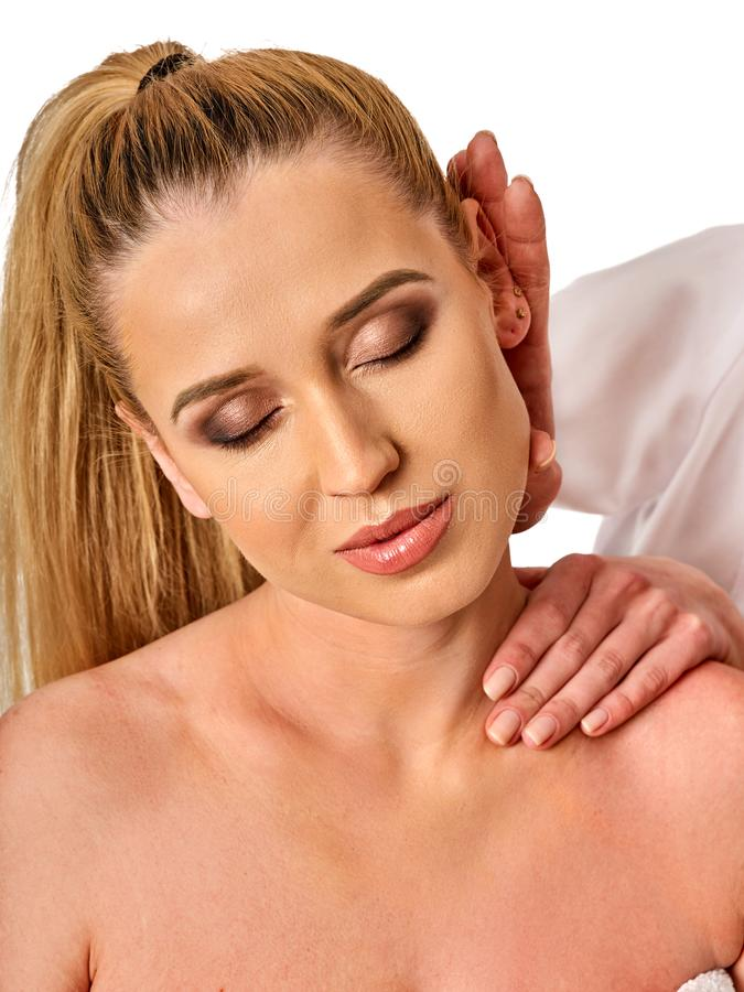 Shoulder and neck massage for woman in spa salon. Shoulder and neck massage for women in spa salon. Doctor making neck therapy in rehabilitation center royalty free stock image