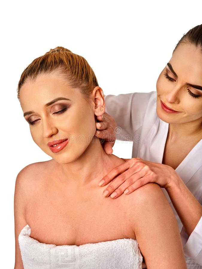 Shoulder and neck massage for woman in spa salon. Shoulder and neck massage for women in spa salon. Doctor making neck therapy in rehabilitation center on royalty free stock photography