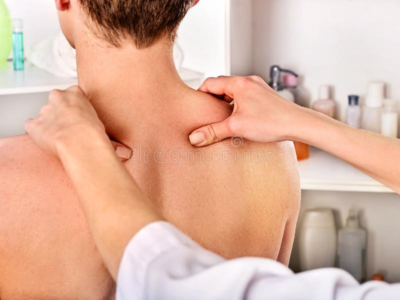 Shoulder and neck massage for woman in spa salon. Shoulder and neck massage for women in spa salon. Doctor making therapy in rehabilitation center royalty free stock photo