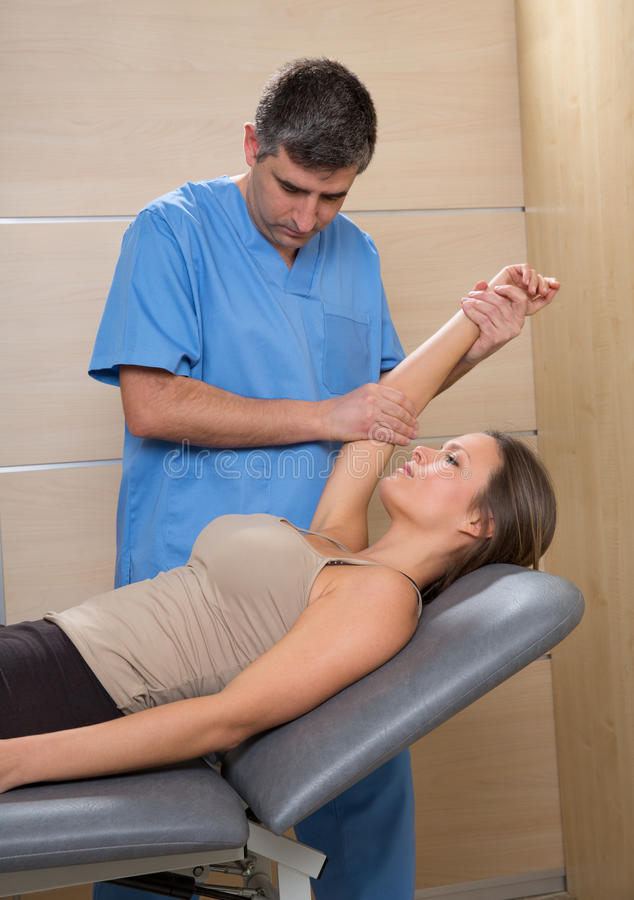 Shoulder physiotherapy doctor therapist and woman patient stock photography