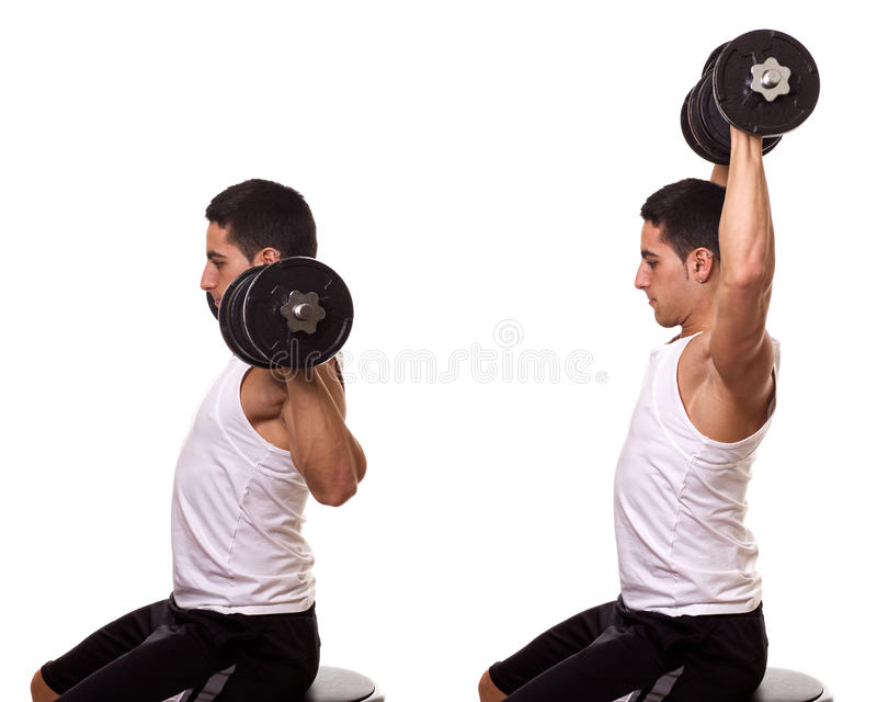 Shoulder Press. Seated shoulder press. Studio shot over white royalty free stock image