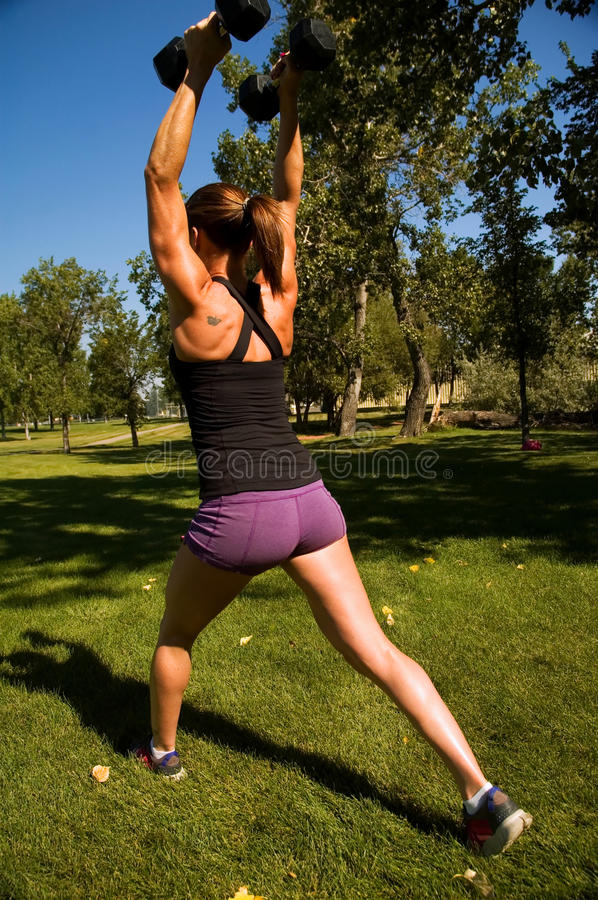 Shoulder Press Lunge royalty free stock photography