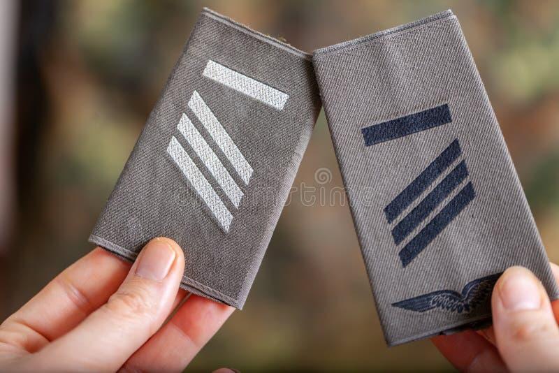 German shoulder ranks on a camouflage background. Shoulder ranks on a camouflage background stock image