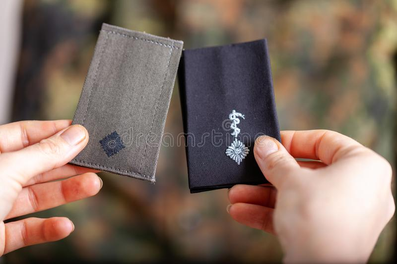 German shoulder ranks on a camouflage background. Shoulder ranks on a camouflage background royalty free stock photography