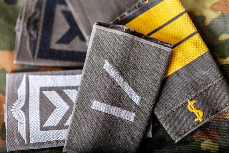 German shoulder ranks on a camouflage background. Shoulder ranks on a camouflage background stock images