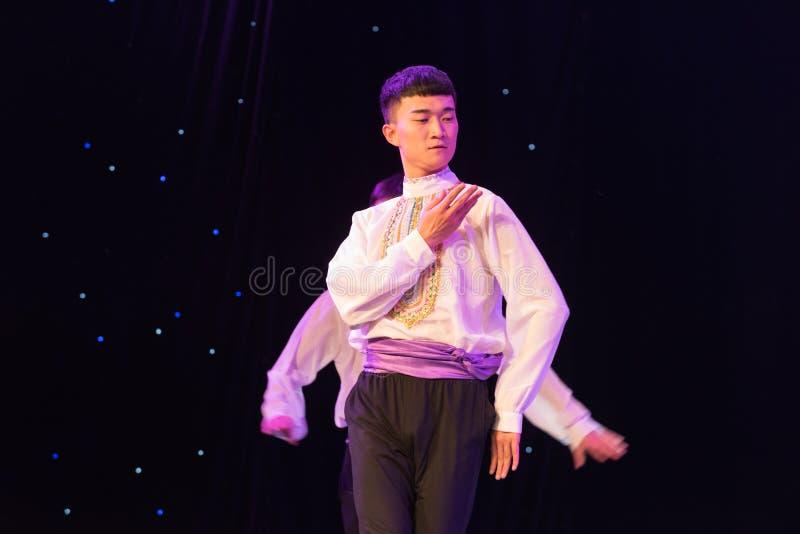 Shoulder Shimmy-Uygur juvenile-Chinese folk dance royalty free stock images