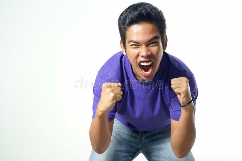 Shouting asian malay male teen stock photography