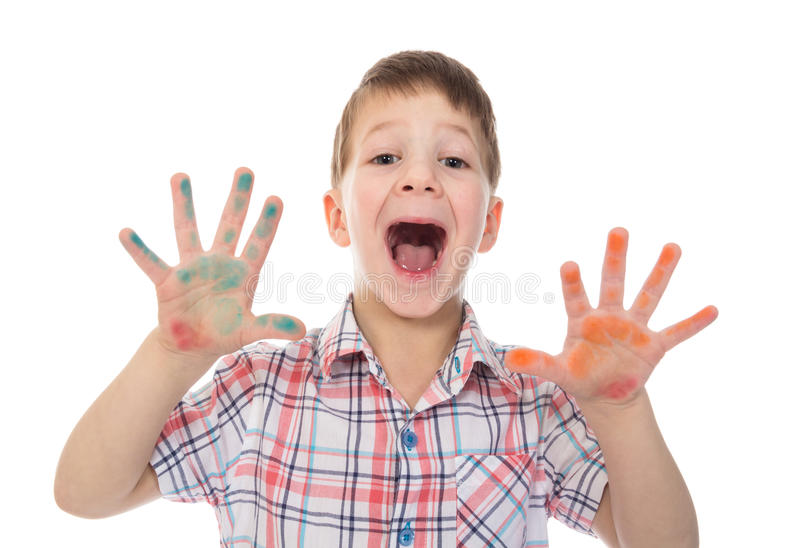 Shouting boy with colorful painted fingers spread stock images