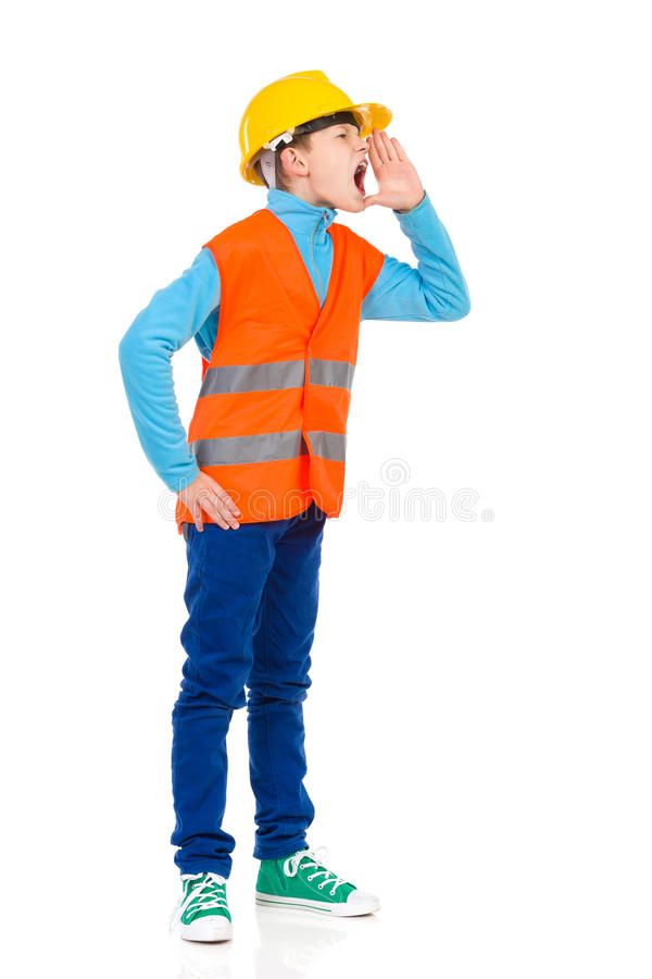Shouting boy. In yellow hardhat and orange reflective vest. Full length studio shot isolated on white royalty free stock images