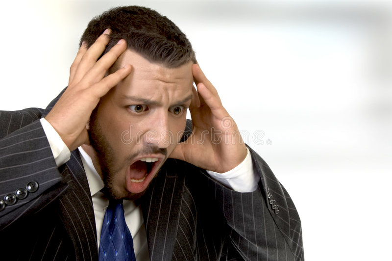 Download Shouting Businessman Holding His Head In His Hands Stock Photo - Image: 6617590
