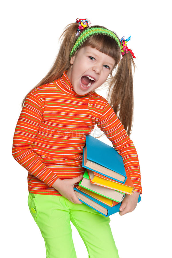 Shouting little girl with books royalty free stock photo