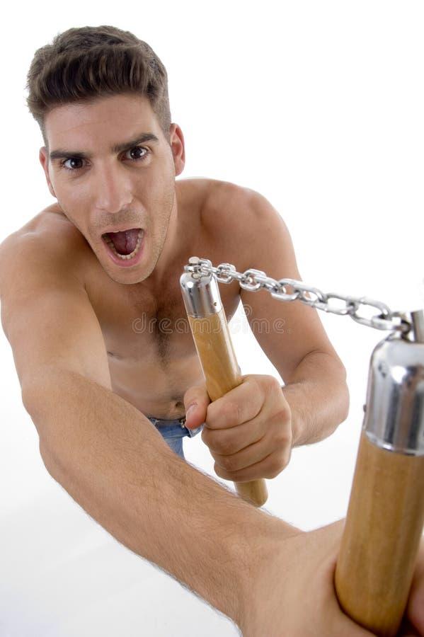 Download Shouting Man Holding Nunchaku Stock Photo - Image: 7083692