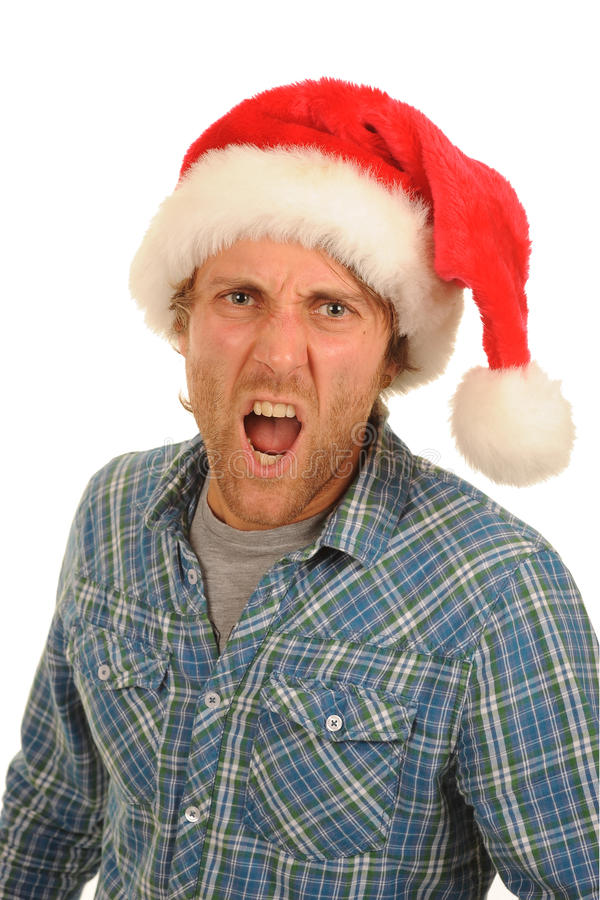 Shouting man Santa hat. Man wearing a Santa hat, shouting loudly royalty free stock photos