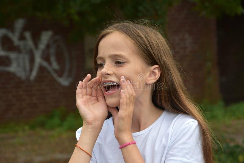 Shouting teenage girl stock photo