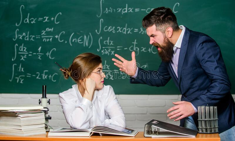 Shouting and waving his hands. Angry teacher or student. Brutal hipster say angry words to pretty woman. Extremely angry royalty free stock photos