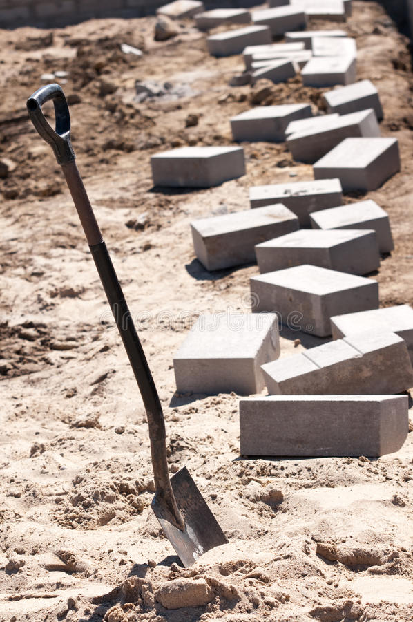 Shovel and bricks. A background of a shovel and bricks for construction royalty free stock images