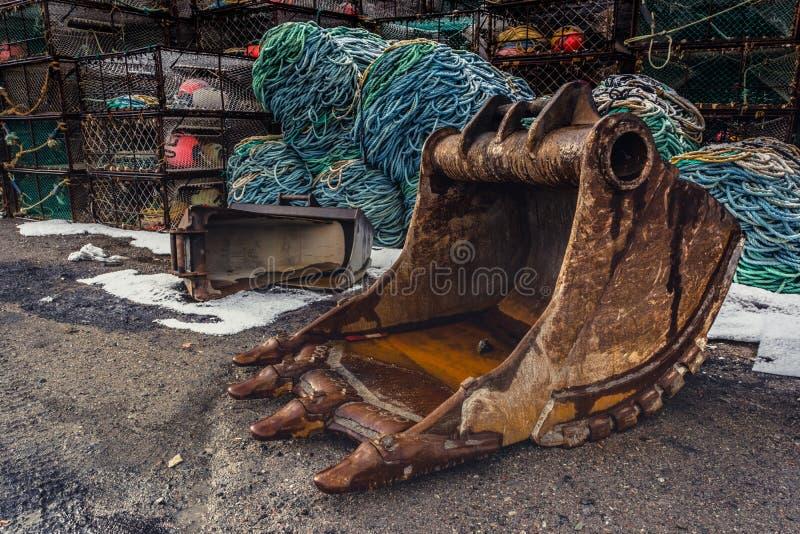 Shovel bucket on the ground stock image