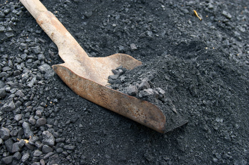 Shovel and coal royalty free stock photography